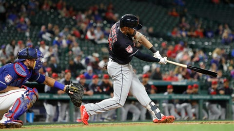 <p>               Cleveland Indians Eric Stamets (66) swings for a grand slam in front of Texas Rangers catcher Jeff Mathis (2) during the fourth inning of an exhibition baseball game in Arlington, Texas, Monday, March 25, 2019. (AP Photo/LM Otero)             </p>