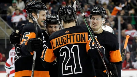<p>               Philadelphia Flyers left wing James van Riemsdyk, far left, celebrates his first-period goal with teammates during the team's NHL hockey game against the New Jersey Devils, Friday, March 1, 2019, in Newark, N.J. (AP Photo/Julio Cortez)             </p>