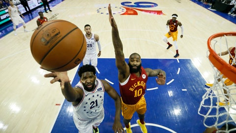 <p>               Philadelphia 76ers' Joel Embiid (21) goes up for a shot past Indiana Pacers' Kyle O'Quinn (10) during the first half of an NBA basketball game, Sunday, March 10, 2019, in Philadelphia. (AP Photo/Matt Slocum)             </p>