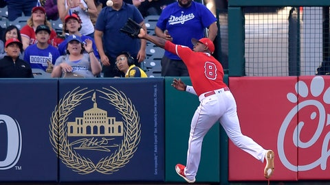 <p>               Los Angeles Angels left fielder Justin Upton tries to field a ball hit for an RBI double by Los Angeles Dodgers' Max Muncy during the first inning of a preseason baseball game Sunday, March 24, 2019, in Anaheim, Calif. Upton was injured on the play and was taken out of the game. (AP Photo/Mark J. Terrill)             </p>