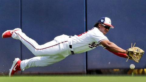 <p>               Washington Nationals right fielder Chuck Taylor dives but is unable to catch a ball hit for a single by Houston Astros' Carlos Correa during the first inning of an exhibition spring training baseball game Sunday, March 3, 2019, in West Palm Beach, Fla. (AP Photo/Jeff Roberson)             </p>