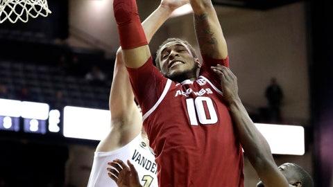 <p>               Arkansas forward Daniel Gafford (10) drives against Vanderbilt defenders in the first half of an NCAA college basketball game Wednesday, March 6, 2019, in Nashville, Tenn. (AP Photo/Mark Humphrey)             </p>
