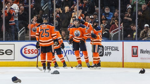<p>               Edmonton Oilers' Darnell Nurse (25), Leon Draisaitl (29) and Joseph Gambardella (45) celebrate Leon Draisaitl's (29) hat trick against the Los Angeles Kings during the third period of an NHL game in Edmonton, Alberta, Tuesday, March 26, 2019. (Jason Franson/The Canadian Press via AP)             </p>