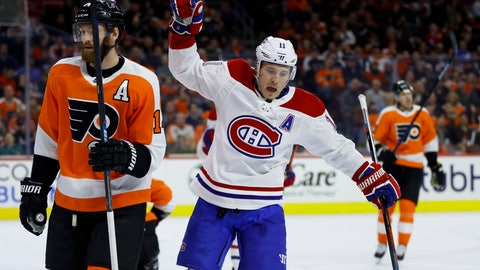 <p>               Montreal Canadiens' Brendan Gallagher, center, celebrates past Philadelphia Flyers' Sean Couturier, left, after scoring a goal during the first period of an NHL hockey game, Tuesday, March 19, 2019, in Philadelphia. (AP Photo/Matt Slocum)             </p>