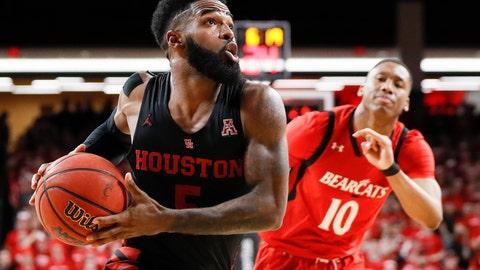 <p>               Houston's Corey Davis Jr., left, drives past Cincinnati's Rashawn Fredericks (10) in the second half of an NCAA college basketball game, Sunday, March 10, 2019, in Cincinnati. (AP Photo/John Minchillo)             </p>