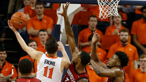 <p>               Virginia guard Ty Jerome (11) goes up to shoot as Louisville forward V.J. King (13) and Louisville center Steven Enoch, right defend during the first half of an NCAA college basketball game in Charlottesville, Va., Saturday, March 9, 2019. (AP Photo/Steve Helber)             </p>