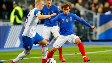 <p>               France's Antoine Griezmann, right, challenges for the ball with Iceland's Hordur Magnusson during the Euro 2020 group H qualifying soccer match between France and Iceland at Stade de France stadium in Saint Denis, outside Paris, France, Monday, March 25, 2019. (AP Photo/Michel Euler)             </p>
