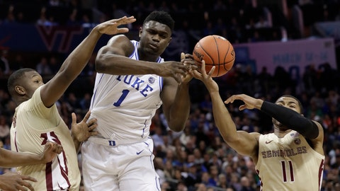 <p>               Duke's Zion Williamson, center, loses the ball as he is trapped by Florida State's David Nichols, right, and Raiquan Gray, left, during the first half of the NCAA college basketball championship game of the Atlantic Coast Conference tournament in Charlotte, N.C., Saturday, March 16, 2019. (AP Photo/Chuck Burton)             </p>