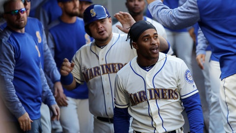 <p>               Seattle Mariners' Mallex Smith, right, and Daniel Vogelbach, center, are greeted in the dugout after they scored on a double by Mitch Haniger during the third inning of a baseball game against the Boston Red Sox, Sunday, March 31, 2019, in Seattle. (AP Photo/Ted S. Warren)             </p>