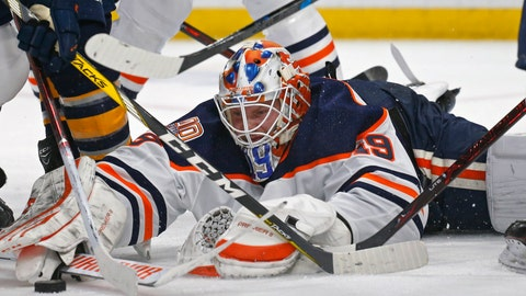 <p>               Edmonton Oilers goalie Mikko Koskinen (19) reaches for the puck during the third period of an NHL hockey game against the Buffalo Sabres, Monday, March 4, 2019, in Buffalo N.Y. (AP Photo/Jeffrey T. Barnes)             </p>