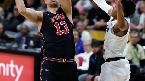 <p>               Utah forward Novak Topalovic, left, goes up for a basket as Colorado guard Shane Gatling defends in the first half of an NCAA college basketball game Saturday, March 2, 2019, in Boulder, Colo. (AP Photo/David Zalubowski)             </p>