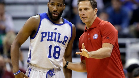 <p>               FILE - In this July 7, 2015, file photo, Philadelphia 76ers' Deonte Burton (18) speaks with his summer league coach Billy Lange during the first half of an NBA summer league basketball game in Salt Lake City. Saint Joseph's University has hired Philadelphia 76ers assistant Billy Lange as its new basketball coach, the school said Thursday, March 28, 2019.  Lange succeeds longtime coach Phil Martelli, who was fired earlier this month after three straight losing seasons. (AP Photo/Rick Bowmer, File)             </p>