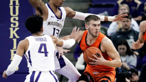 <p>               Oregon State forward Tres Tinkle, right, looks to pass around the defense of Washington guard Matisse Thybulle (4) and forward Hameir Wright (13) during the first half of an NCAA college basketball game Wednesday, March 6, 2019 in Seattle. (AP Photo/Ted S. Warren)             </p>