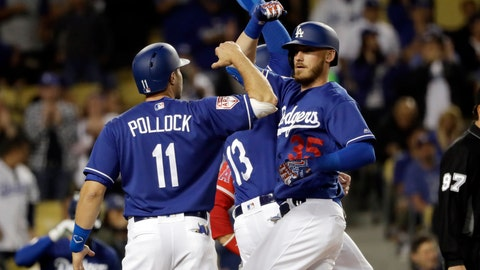 <p>               CORRECTS LOCATION TO LOS ANGELES - Los Angeles Dodgers' Cody Bellinger, right, celebrates his three-run home run at home plate with teammates Max Muncy, center, and A.J. Pollock (11) during the second inning of a preseason baseball game against the Los Angeles Angels Tuesday, March 26, 2019, in Los Angeles, Calif. (AP Photo/Marcio Jose Sanchez)             </p>