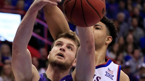 <p>               Kansas State forward Dean Wade (32) rebounds in front of Kansas guard Quentin Grimes, back, during the second half of an NCAA college basketball game in Lawrence, Kan., Monday, Feb. 25, 2019. (AP Photo/Orlin Wagner)             </p>