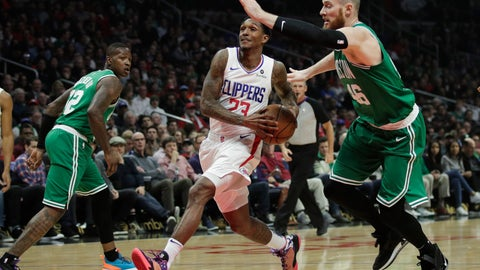 <p>               Los Angeles Clippers' Lou Williams, center, drives to the basket under pressure by Boston Celtics' Aron Baynes during the first half of an NBA basketball game, Monday, March 11, 2019, in Los Angeles. (AP Photo/Jae C. Hong)             </p>