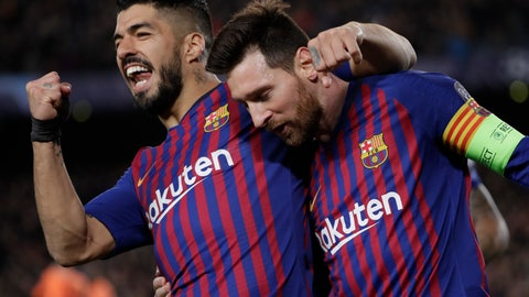 <p>               Barcelona's Lionel Messi, right and Barcelona's Luis Suarez celebrate after Messi scored his side's third goal during the Champions League round of 16, 2nd leg, soccer match between FC Barcelona and Olympique Lyon at the Camp Nou stadium in Barcelona, Spain, Wednesday, March 13, 2019. (AP Photo/Emilio Morenatti)             </p>