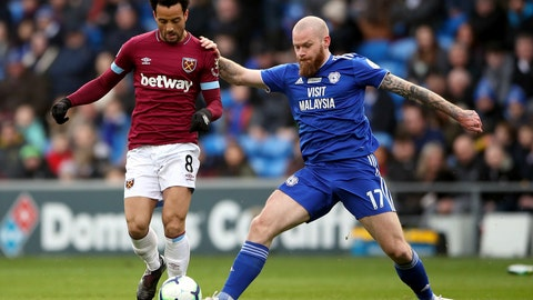 <p>               Cardiff City's Aron Gunnarsson, right, and West Ham United's Felipe Anderson in action during their English Premier League soccer match at the Cardiff City Stadium, in Cardiff, Wales, Saturday March 9, 2019. (Nick Potts/PA via AP)             </p>