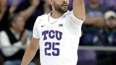 <p>               TCU guard Alex Robinson (25) celebrates sinking a three-point basket in the first half of an NCAA college basketball game against Kansas State in Fort Worth, Texas, Monday, March 4, 2019. (AP Photo/Tony Gutierrez)             </p>