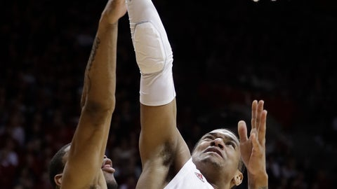 <p>               Indiana's Devonte Green (11) puts up a shot against Arkansas's Reggie Chaney during the second half in the second round of the NIT college basketball tournament, Saturday, March 23, 2019, in Bloomington, Ind. Indiana won 63-60. (AP Photo/Darron Cummings)             </p>