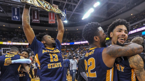 <p>               Murray State's Brion Whitley (22) hugs Tevin Brown (10) as Devin Gilmore (13) celebrates behind them the team's win over Belmont in an NCAA college basketball game for the championship of the Ohio Valley Conference men's tournament Saturday, March 9, 2019, in Evansville, Ind. (AP Photo/Daniel R. Patmore)             </p>