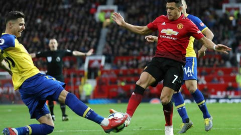 <p>               Southampton's Jan Bednarek, left, challenges Manchester United's Alexis Sanchez during their English Premier League soccer match at Old Trafford, Manchester, England, Saturday, March 2, 2019. (Martin Rickett/PA via AP)             </p>