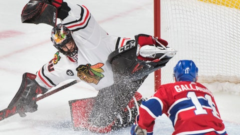 <p>               Montreal Canadiens' Brendan Gallagher and Chicago Blackhawks goaltender Corey Crawford look for the puck during the second period of an NHL hockey game in Montreal, Saturday, March 16, 2019. (Graham Hughes/The Canadian Press via AP)             </p>