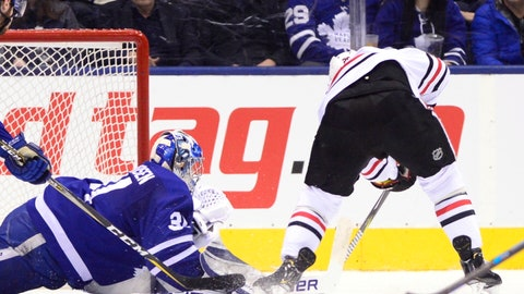 <p>               Chicago Blackhawks left wing Brandon Saad (20) scores past Toronto Maple Leafs goaltender Frederik Andersen (31) during the first period of an NHL hockey game Wednesday, March 13, 2019, in Toronto. (Frank Gunn/The Canadian Press via AP)             </p>