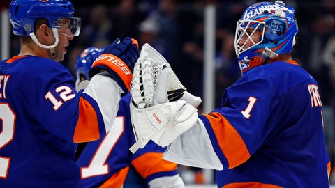 <p>               New York Islanders goaltender Thomas Greiss (1) celebrates with right wing Josh Bailey (12) after defeating the Columbus Blue Jackets 2-0 in an NHL hockey game Monday, March 11, 2019, in Uniondale, N.Y. (AP Photo/Adam Hunger)             </p>