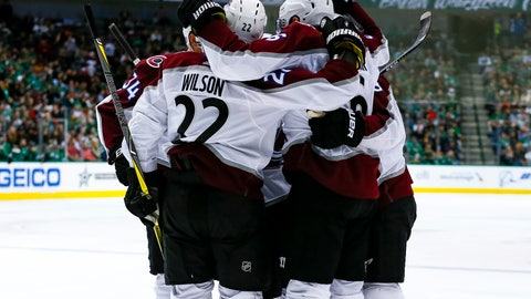 <p>               Colorado Avalanche's Colin Wilson (22) and Carl Soderberg (34) celebrate with teammates after defenseman Erik Johnson scoresd a goal during the second period of the team's NHL hockey game against the Dallas Stars in Dallas, Thursday, March 21, 2019. (AP Photo/Sam Hodde)             </p>