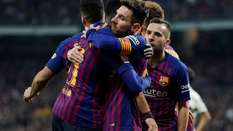 <p>               Barcelona forward Lionel Messi, center, celebrates with Barcelona forward Luis Suarez celebrates after Real defender Raphael Varane scores an own goal during the Copa del Rey semifinal second leg soccer match between Real Madrid and FC Barcelona at the Bernabeu stadium in Madrid, Spain, Wednesday Feb. 27, 2019. (AP Photo/Andrea Comas)             </p>