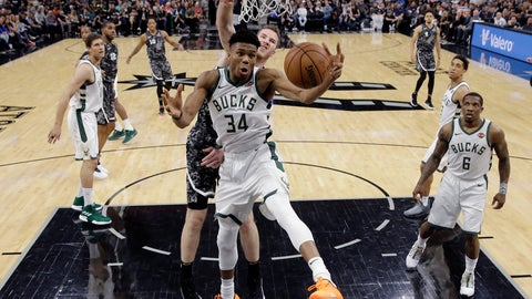 <p>               Milwaukee Bucks forward Giannis Antetokounmpo (34) pulls down a rebound in front of San Antonio Spurs center Jakob Poeltl (25) during the first half of an NBA basketball game, in San Antonio, Sunday, March 10, 2019. (AP Photo/Eric Gay)             </p>