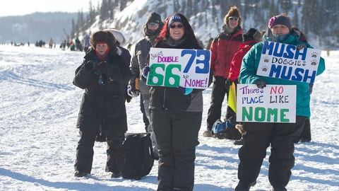 <p>               FILE - In this March 6, 2017, file photo, Melissa, center, and Sarah, right, Burnett, both of Fairbanks, hoist handmade signs for passing Iditarod mushers on the Chena River in Fairbanks, Alaska. The women are avid race fans, following the mushers' GPS trackers obsessively and staying as up-to-date as possible with all race news. Technology has increasingly made the 47-year-old race more immediate to fans and safer for competitors, said Chas St. George, acting CEO of the Iditarod Trail Committee, the race's governing board. (AP Photo/Ellamarie Quimby, File)             </p>