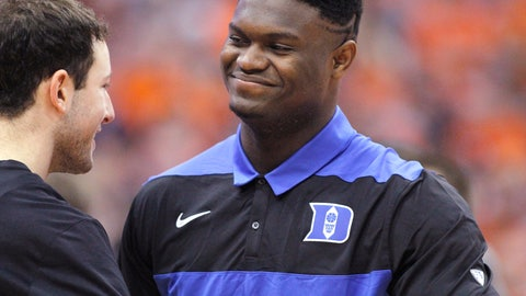 <p>               Duke's Zion Williamson, right, is greeted by a teammate on the court before the team's NCAA college basketball game against Syracuse in Syracuse, N.Y., Saturday, Feb. 23, 2019. (AP Photo/Nick Lisi)             </p>