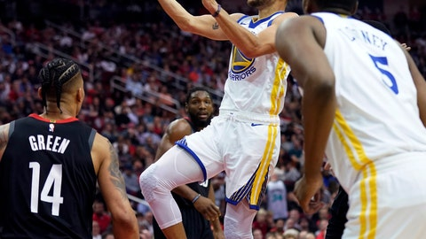 <p>               Golden State Warriors' Stephen Curry, center, shoots as Houston Rockets' Gerald Green (14) defends during the first half of an NBA basketball game, Wednesday, March 13, 2019, in Houston. (AP Photo/David J. Phillip)             </p>