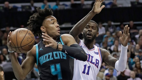 <p>               Charlotte Hornets' Devonte' Graham (4) looks to pass as Philadelphia 76ers' James Ennis III (11) defends during the first half of an NBA basketball game in Charlotte, N.C., Tuesday, March 19, 2019. (AP Photo/Chuck Burton)             </p>