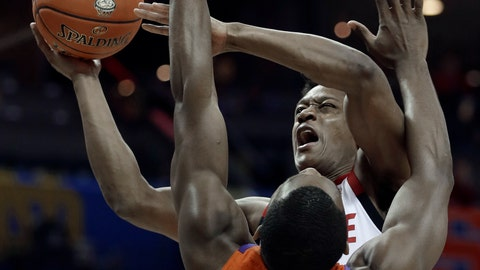 <p>               North Carolina State's C.J. Bryce, top. shoots over Clemson's Aamir Simms (25) during the first half of an NCAA college basketball game in the Atlantic Coast Conference tournament in Charlotte, N.C., Wednesday, March 13, 2019. (AP Photo/Nell Redmond)             </p>