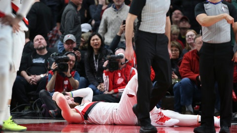 <p>               Portland Trail Blazers center Jusuf Nurkic, on ground, was injured and left the court on a stretcher as the Blazers beat the Brooklyn Nets in double overtime, 148-144, during an NBA basketball game in Portland, Ore., Monday, March 25, 2019. (AP Photo/Randy L. Rasmussen)             </p>