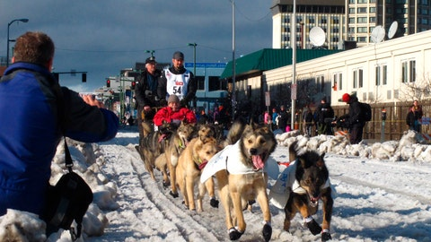 <p>               FILE - In this March 7, 2015, file photo, musher Peter Kaiser, of Bethel, Alaska, leads his team past spectators during the ceremonial start of the Iditarod Trail Sled Dog Race, in Anchorage, Alaska. There's a new leader in the Iditarod Trail Sled Dog Race after the dogs on musher Nicolas Petit's team quit on him. Alaska musher Pete Kaiser passed Petit and was the first musher to reach the checkpoint in Koyuk Monday, March 11, 2019. (AP Photo/Rachel D'Oro, File)             </p>