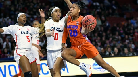 <p>               Florida's Delicia Washington  right, drives to the basket while defended by Mississippi's Gabby Crawford, center, and Crystal Allen during the second half of a women's Southeastern conference NCAA basketball tournament game Wednesday, March 6, 2019, in Greenville, S.C. (AP Photo/Richard Shiro)             </p>