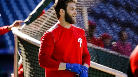 <p>               Philadelphia Phillies' Bryce Harper pulls on his gloves for batting practice, Tuesday, March 26, 2019, in Philadelphia. (AP Photo/Matt Rourke)             </p>