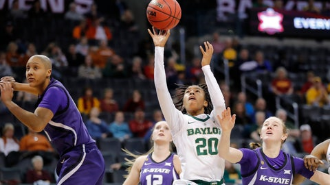 <p>               Baylor guard Juicy Landrum (20) shoots between Kansas State guard Rachel Ranke (12) and Kansas State forward Laura Macke (13) during the first half of an NCAA college basketball game in the Big 12 women's conference tournament in Oklahoma City, Sunday, March 10, 2019. (AP Photo/Alonzo Adams)             </p>