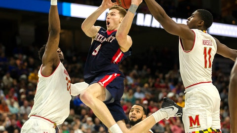 <p>               Belmont 's Dylan Windler, center, goes to the basket between Maryland 's Bruno Fernando, left, and Darryl Morsell (11) during the second half of the first round men's college basketball game in the NCAA Tournament in Jacksonville, Fla. Thursday, March 21, 2019. (AP Photo/Stephen B. Morton)             </p>