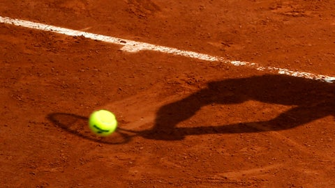 <p>               FILE - In this May 28, 2016 file photo, a player's shadow is pictured as he returns the ball during the French Open tennis tournament at the Roland Garros stadium, in Paris. Judicial officials say Thursday March 21, 2019 that French police have questioned another batch of players about their links to an alleged match-fixing syndicate suspected of paying out hundreds of thousands of euros (dollars) to fix low-level tennis matches. (AP Photo/Alastair Grant, File)             </p>