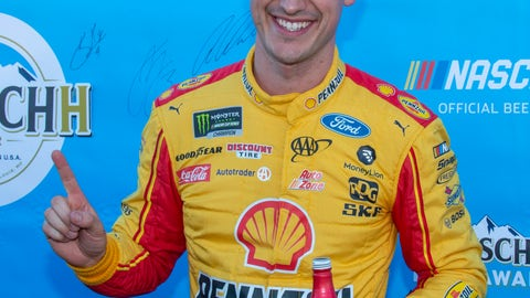 <p>               Joey Logano reacts after winning the pole position for a NASCAR Cup Series auto race at Martinsville Speedway in Martinsville, Va., Saturday, March 23, 2019. (AP Photo/Matt Bell)             </p>
