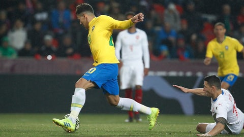 <p>               Brazil's Roberto Firmino, left, breaks away from Czech Republic's Marek Suchy, right, to score his side's first goal during the international friendly soccer match between the Czech Republic and Brazil at the Sinobo stadium in Prague, Czech Republic, Tuesday, March 26, 2019. (AP Photo/Petr David Josek)             </p>