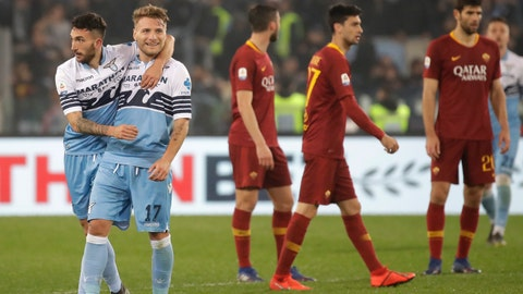 <p>               Lazio's Danilo Cataldi, left, celebrates with teammate Ciro Immobile after scoring his side's third goal during a Serie A soccer match between Lazio and Roma at Rome's Olympic stadium, Italy, Saturday, March 2, 2019. (AP Photo/Alessandra Tarantino)             </p>