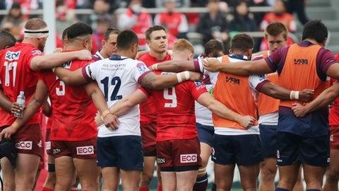 <p>               Players offer a silent prayer for victims of a mass shooting at New Zealand before their Super Rugby match between Sunwolves and Reds in Tokyo, Saturday, March 16, 2019. (AP Photo/Koji Sasahara)             </p>
