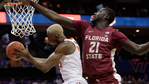 <p>               Virginia's Mamadi Diakite, left, drives past Florida State's Christ Koumadje, right, during the first half of an NCAA college basketball game in the Atlantic Coast Conference tournament in Charlotte, N.C., Friday, March 15, 2019. (AP Photo/Chuck Burton)             </p>