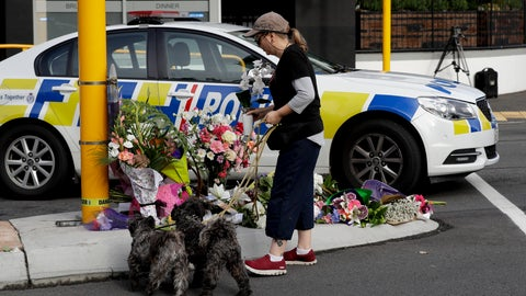 <p>               A women places flowers at a makeshift memorial near the Masjid Al Noor mosque in Christchurch, New Zealand, Saturday, March 16, 2019, where one of the mass shootings occurred yesterday. (AP Photo/Mark Baker)             </p>